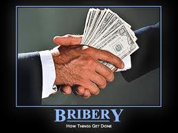 Money being transferred as men shake hands NJ bribe lawyers represent people charged with soliciting or giving New Jersey or federal bribe